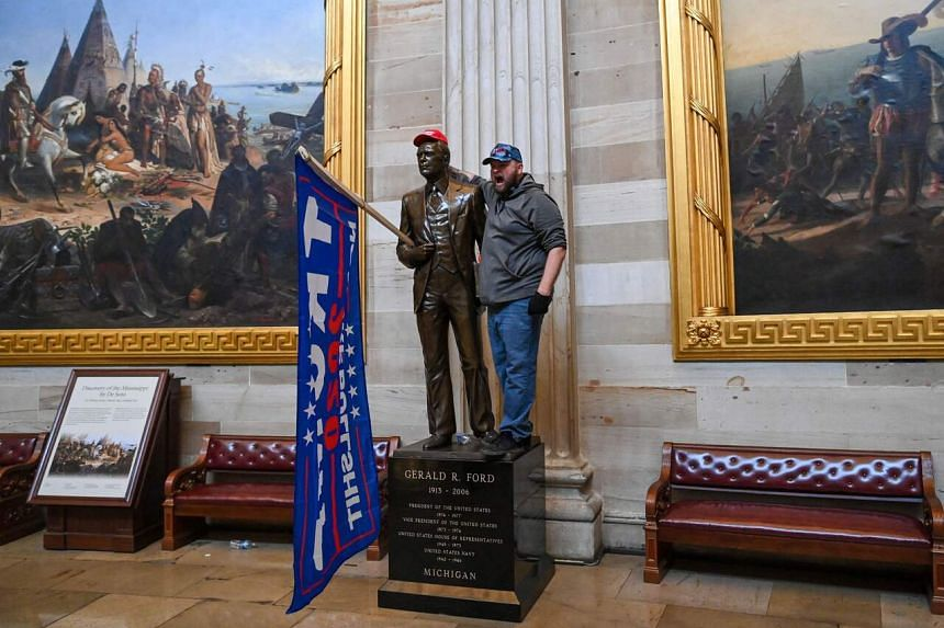 A Trump supporter in the US Capitol's Rotunda on Jan 6, 2021.