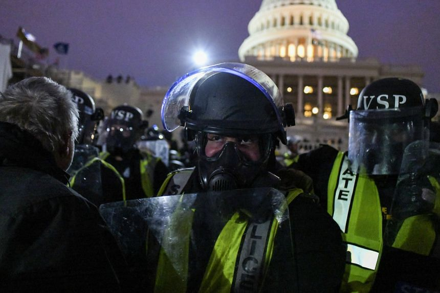 Supporters of President Donald Trump being pushed back by police outside the Capitol in Washington on Jan 6, 2021.