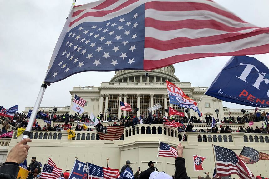 Supporters of US President Donald Trump occupying the US Capitol building in Washington on Jan 6, 2021.