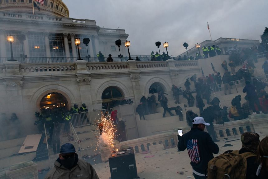 A flashbang grenade exploding as law enforcement pushes back demonstrators in Washington on Jan 6, 2021.