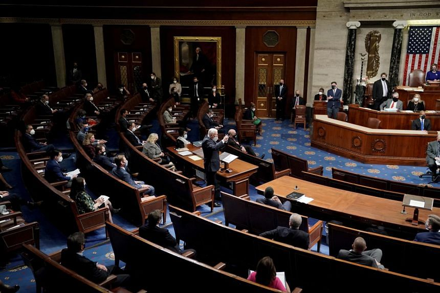The United States Congress reconvening in the House Chamber in the US Capitol  in Washington on Jan 6, 2021.