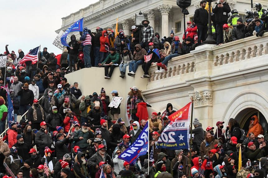 Supporters of US President Donald Trump are seen at the Capitol building in Washington on Jan 6, 2021.