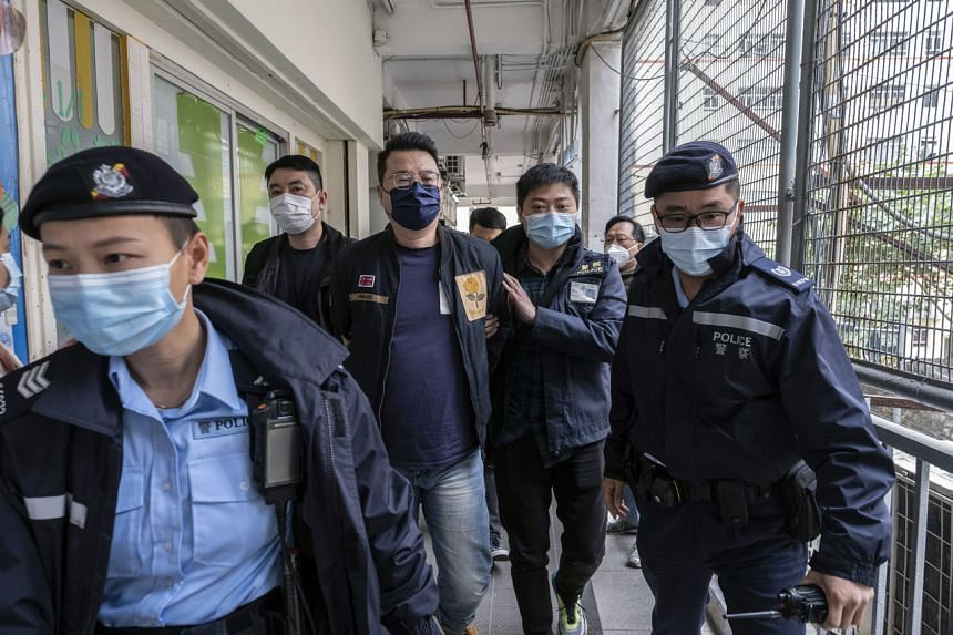 Police officers escort Andrew Wan, a pro-democracy politician in Hong Kong, on Jan 6, 2021.