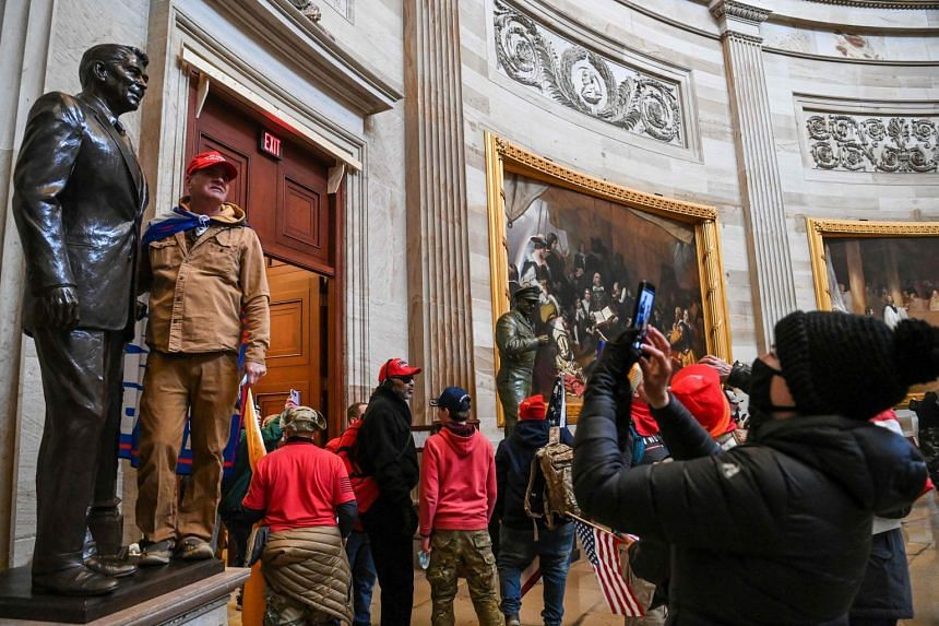 Supporters of US President Donald Trump enter the US Capitol's Rotunda in Washington on Jan 6, 2021.