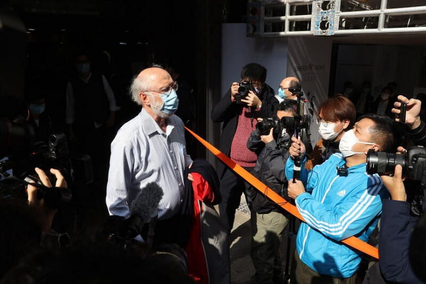 US human rights lawyer John Clancey being escorted by police after his arrest in Hong Kong on Jan 6, 2021.