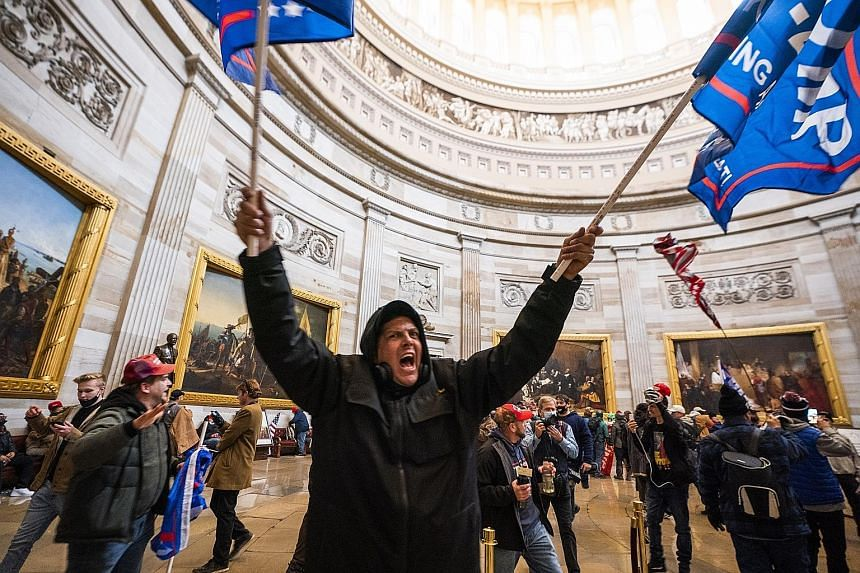 Trump supporters in the Capitol Rotunda after storming the United States Capitol building on Wednesday, forcing lawmakers to flee to safety and suspending proceedings to discuss the states' Electoral College votes for last November's presidential ele