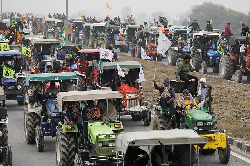 In one of the biggest shows of strength, farmers participating in a tractor rally to protest against three new farm laws, at Singhu border near New Delhi, yesterday. PHOTO: REUTERS
