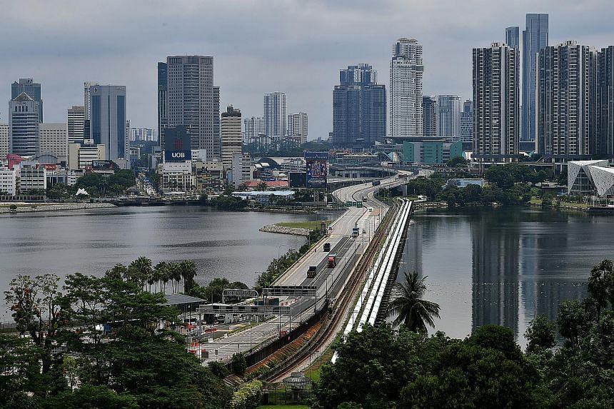 The Periodic Commuting Arrangement scheme will let them return to Malaysia for a short time after working in Singapore for at least 90 days.