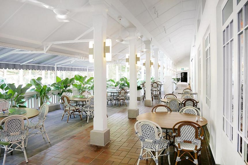 The patio at Long Beach @ Dempsey has been given a colonial feel with black-and- white rattan chairs.