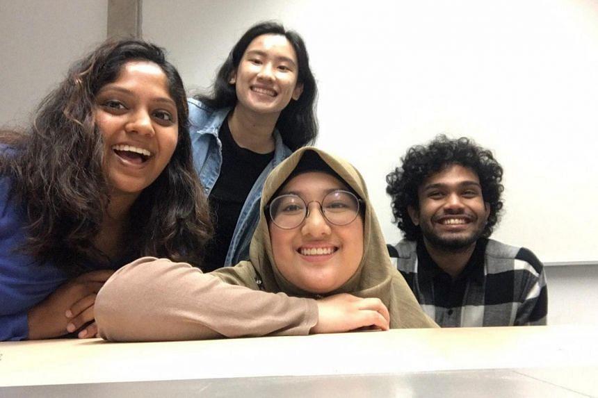 (From left) Ms Sambhavi Rajangam, Ms Joey Chung, Ms Shukrina Salam and Mr Abhyuday Samadder have developed CalculAID, available free of charge in five languages - Tamil, Bengali, Mandarin, Malay and Burmese.