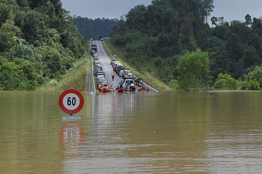 A road connecting Bandar Al-Muktafi Billah Shah in Terengganu to three villages is submerged, on Jan 7, 2021.
