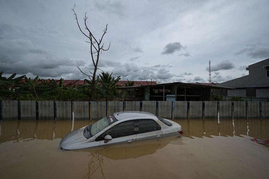 A submerged car is seen following heavy monsoon rain, in Kampung Desa Bakti, Pahang, on Jan 7, 2021.