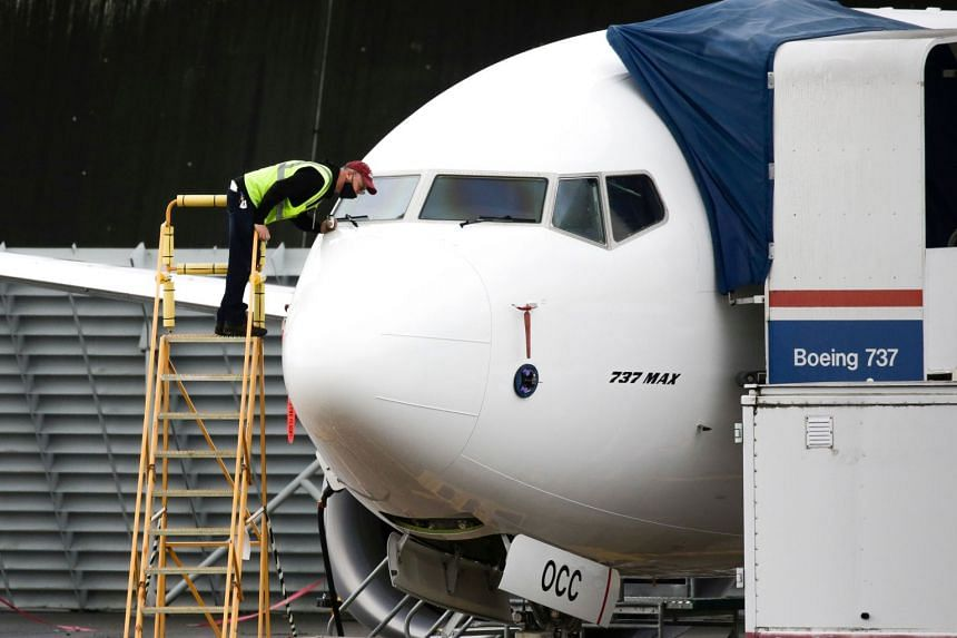 A worker inspects a Boeing 737 Max airliner at Renton Airport in Washington on Nov 10, 2020.