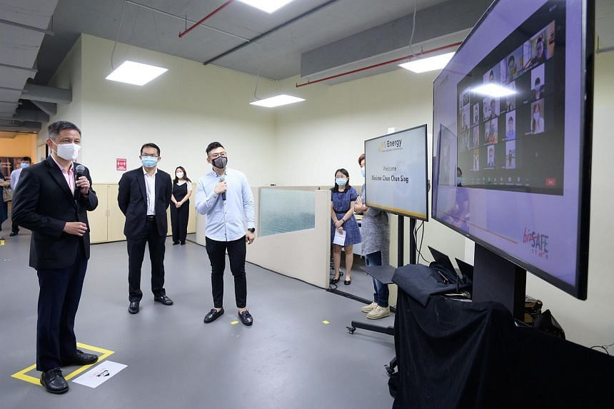 Minister for Trade and Industry Chan Chun Sing (first from left) on a tour of wholesale trade company PS Energy's facility in Bulim Avenue.