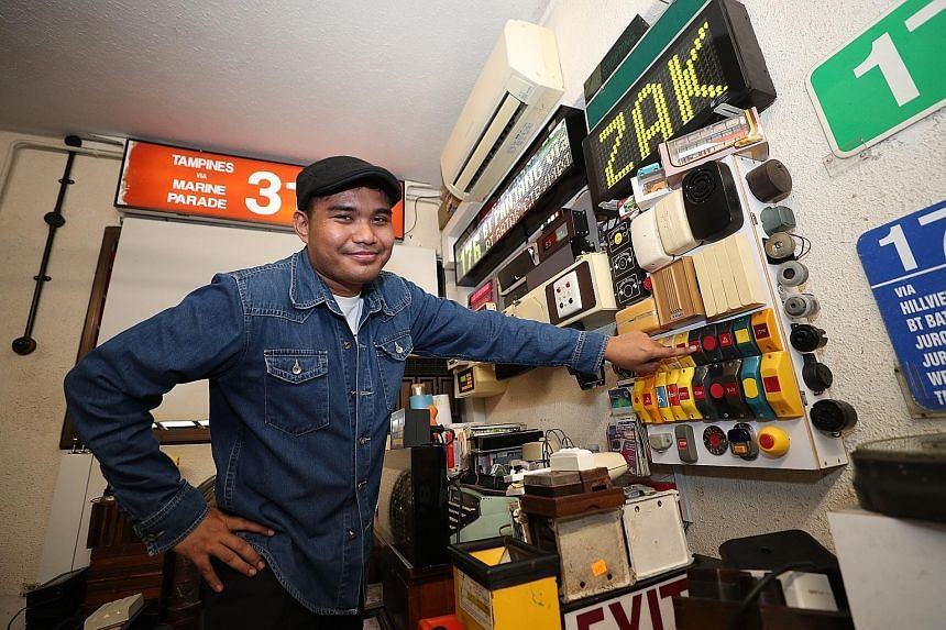Train controller Muhammad Zakaria Azmi with a collection of functioning bus door bells from the 1980s to the present.