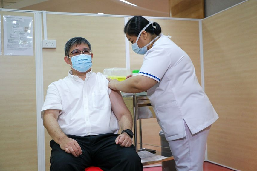 The Health Ministry's director of medical services Kenneth Mak receiving the Covid-19 vaccine at Singapore General Hospital on Jan 8, 2021.
