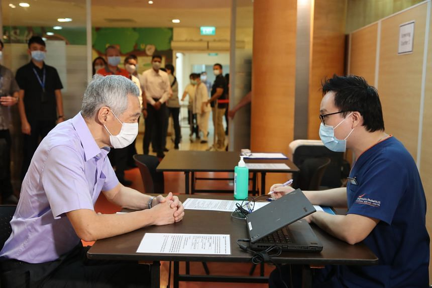 PM Lee was at Singapore General Hospital to observe the start of inoculations for healthcare workers.
