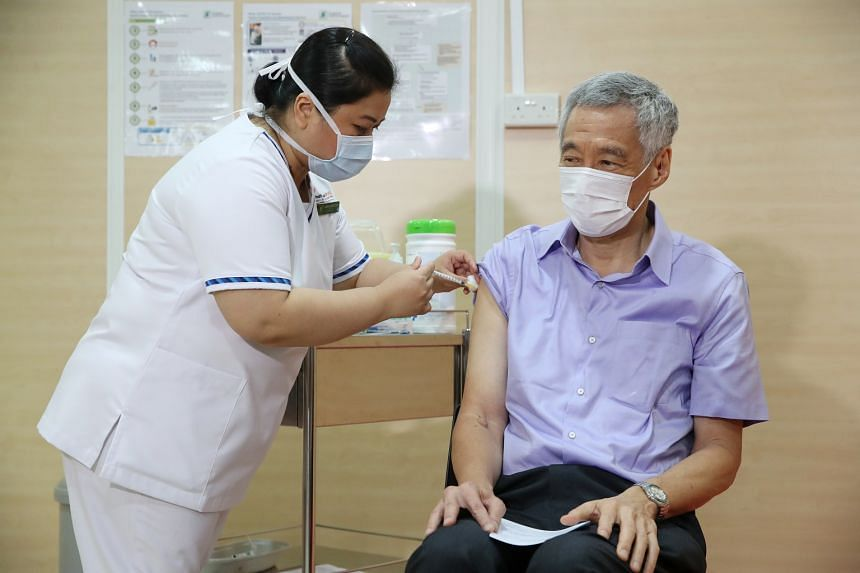 PM Lee receiving the Covid-19 vaccine at Singapore General Hospital on Jan 8, 2021.