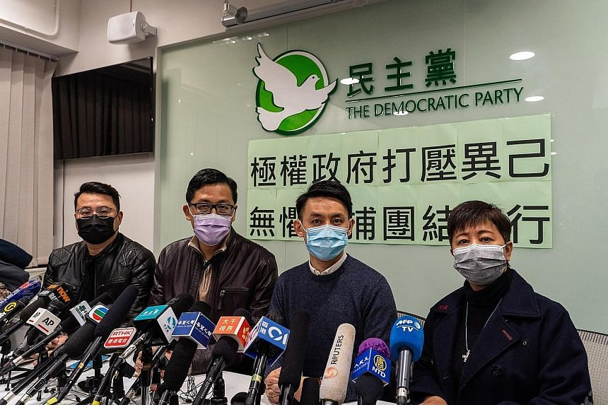 Hong Kong Democratic Party members (from left) Andrew Wan, Lam Cheuk-ting, Lo Kin-hei and Helena Wong at a conference they called yesterday after being released on bail following their arrests under the city's national security law. They were among 5