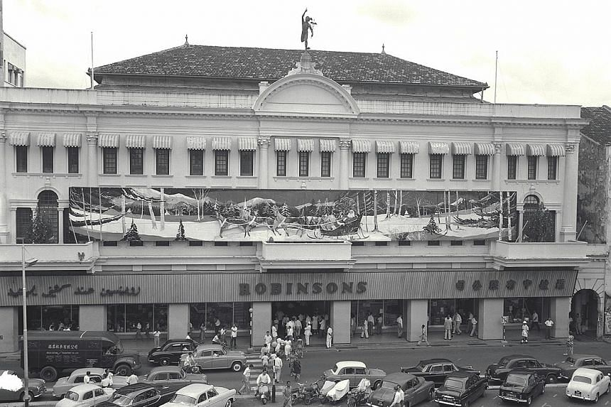 A mural of Santa Claus riding on a sleigh outside the Robinson & Co store at Raffles Chambers (above) in 1960.
