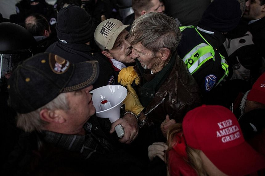Members of law enforcement clashing with pro-Trump protesters as they stormed the US Capitol on Wednesday. Given the current rates of spread of the coronavirus and the crowd size at the event, experts say the virus would have had the ideal opportunit