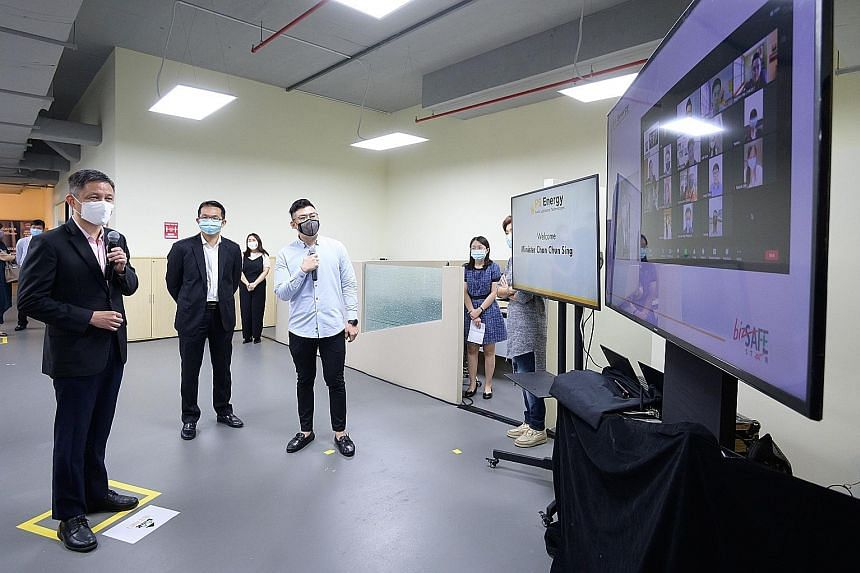 Minister for Trade and Industry Chan Chun Sing (far left) speaking to staff of PS Energy via Zoom during a visit to the wholesale trade firm in Bulim Avenue yesterday. PHOTO: MINISTRY OF TRADE AND INDUSTRY