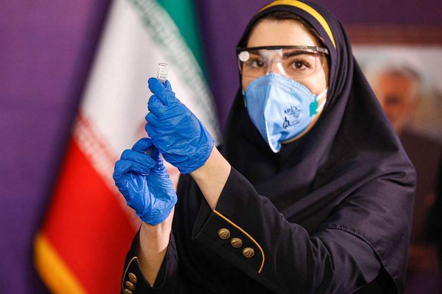 A health worker preparing an injection of a locally-made Iranian Covid-19 vaccine in Teheran on Dec 29, 2020.