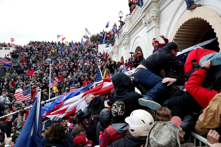 Pro-Trump protesters storm into the US Capitol during clashes with police in Washington, on Jan 6, 2021.