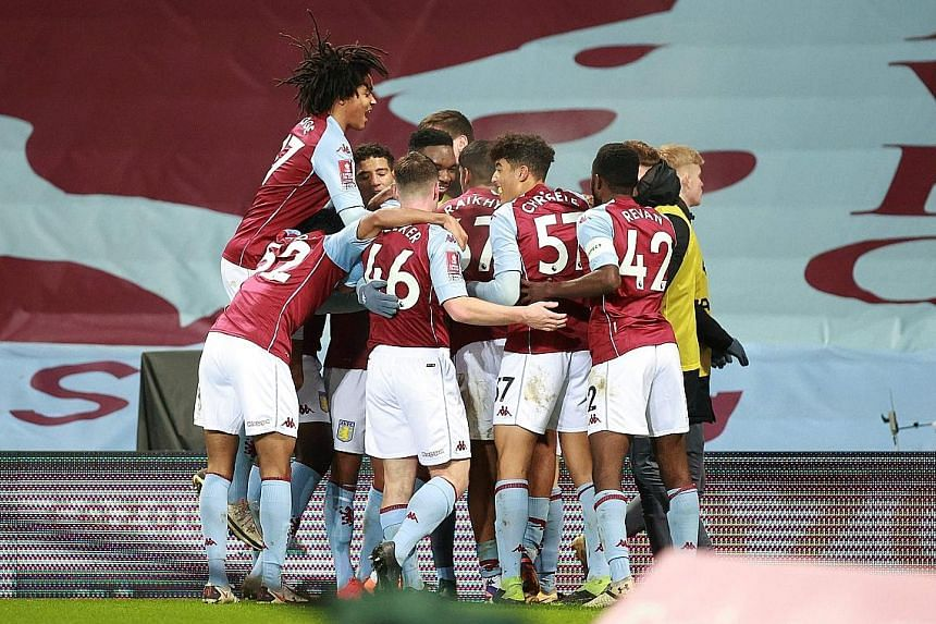 Aston Villa's makeshift team of academy players celebrate Louie Barry's goal against Liverpool in the FA Cup. It was a joy short-lived, however, as Liverpool ran out 4-1 winners.