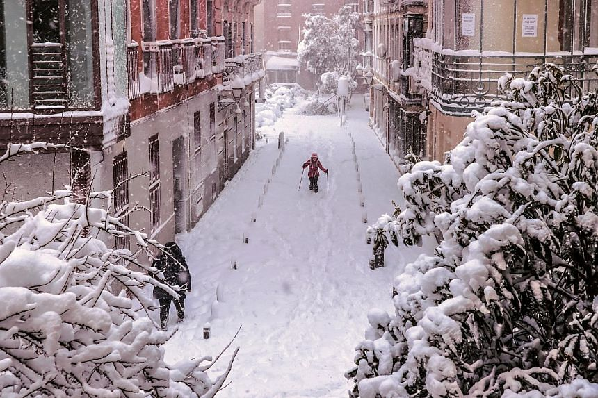 A snow-covered street in Madrid after Storm Filomena brought the heaviest snowfall in the Spanish capital since 1971. Four other regions in Spain were also on red alert yesterday, with more heavy snowfalls forecast.