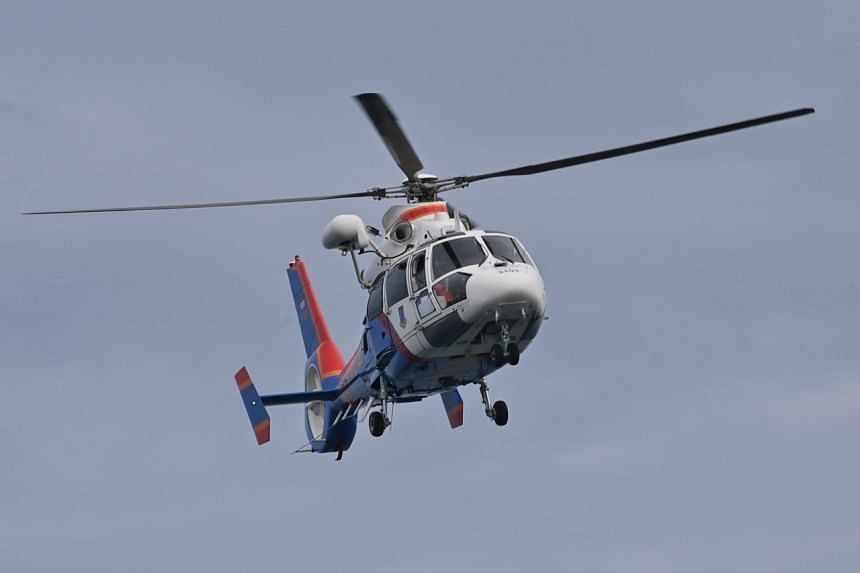 A police helicopter conducts a search operation at sea near Lancang island on Jan 10, 2021.