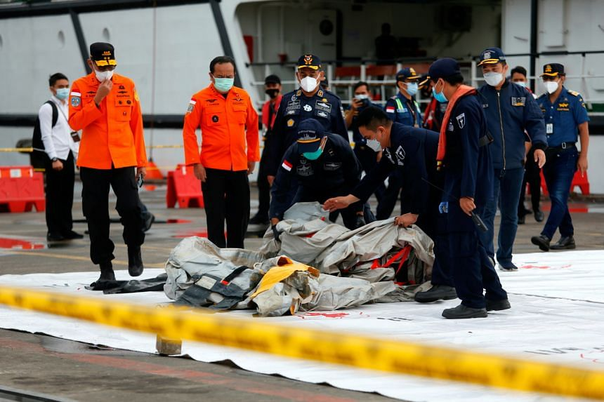Indonesian rescue members carry what is believed to be remains from Sriwijaya Air Flight SJ182 on Jan 10, 2021.