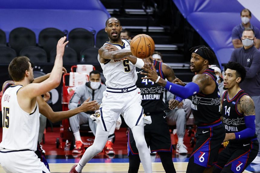 Will Barton of the Denver Nuggets passing the ball during the NBA match against the Philadelphia 76ers on Jan 9, 2021.