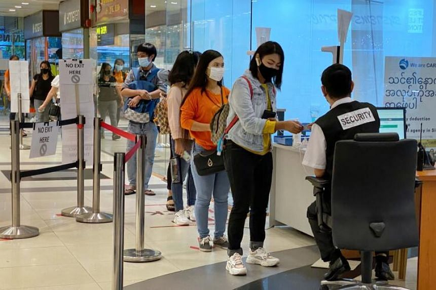 Visitors to Peninsula Plaza having their identity cards scanned, under odd-even identity number restrictions, on Jan 10, 2021.