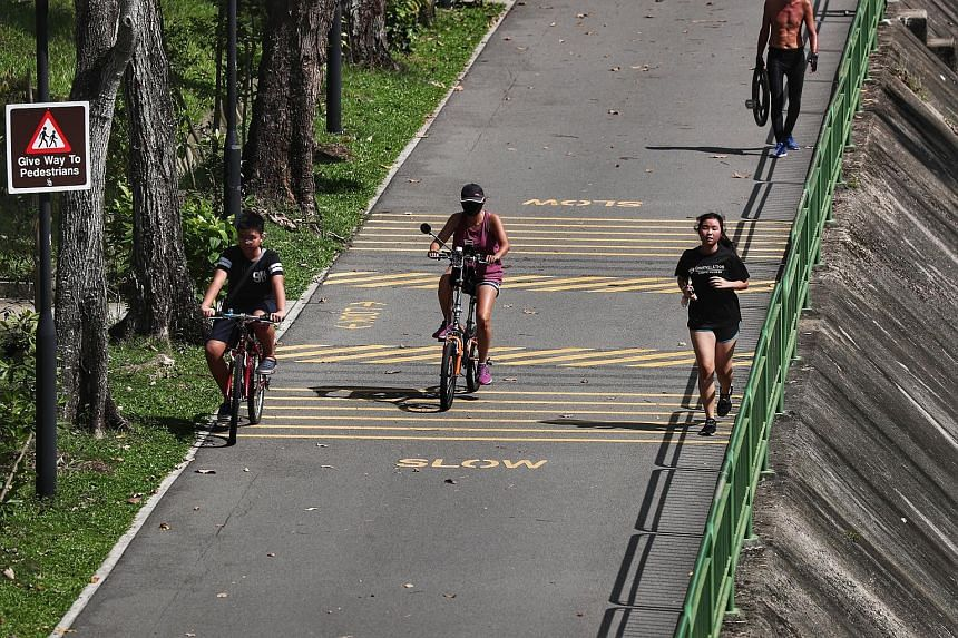 The writer says that the majority of PCN routes are made either of concrete or asphalt, which are not the most ideal surfaces for running as they cause more stress on the feet and legs. ST PHOTO: KELVIN CHNG