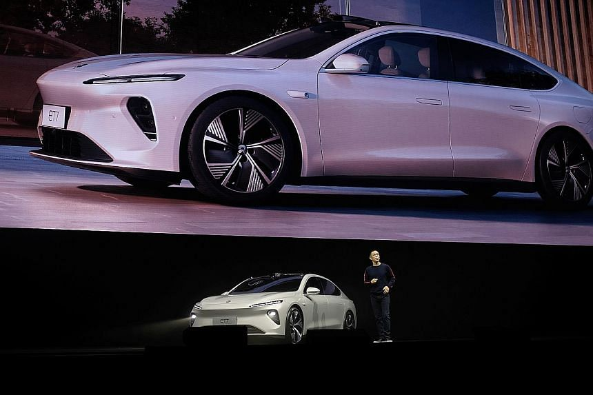 Mr William Li, chief executive of Chinese electric vehicle maker Nio, unveiling the ET7 sedan in Chengdu on Saturday. Prices start at 448,000 yuan (S$91,700) before government subsidies, versus 265,740 yuan for Tesla's Model 3. The US rival sold more