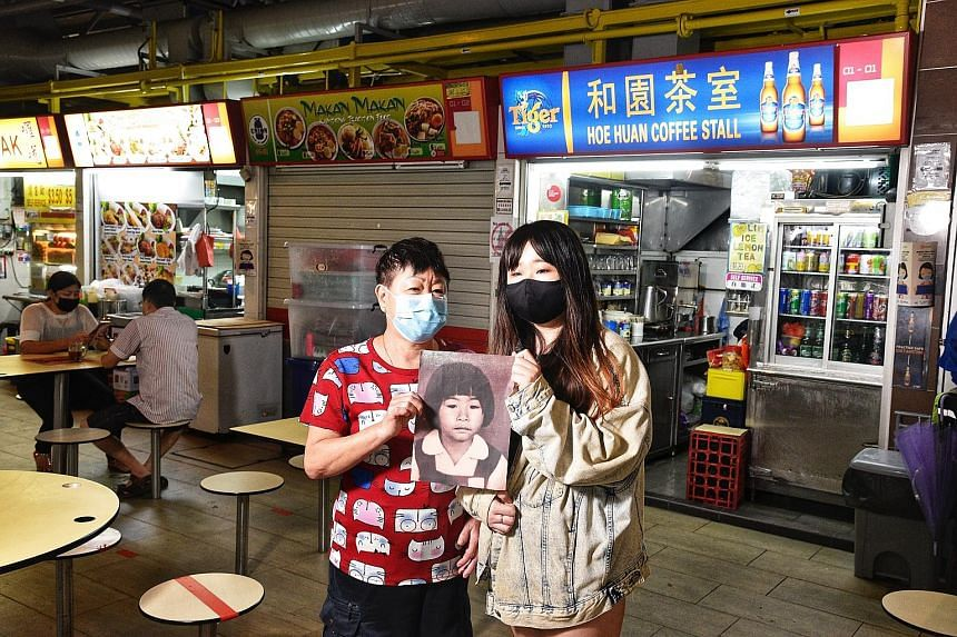 Madam Ang Goon Lay, 65, with her daughter, Lim Jia Hui, 27, holding a picture of then seven-year-old Lim Shiow Rong who was raped and killed in 1995. The murderer was never caught. The pupil was last seen at the coffee shop where her mother worked at