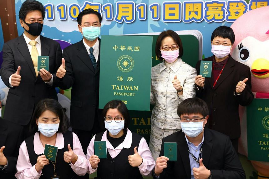 Taiwan's Foreign Minister Joseph Wu shows a sample of the new Taiwanese passport in Taipei, on Jan 11, 2021.