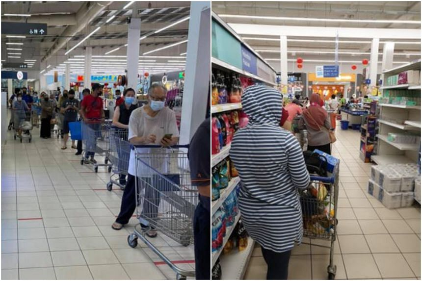 Shoppers queueing at supermarkets in Kuala Lumpur on Jan 8, to stock up on supplies ahead of widely expected movement curbs.