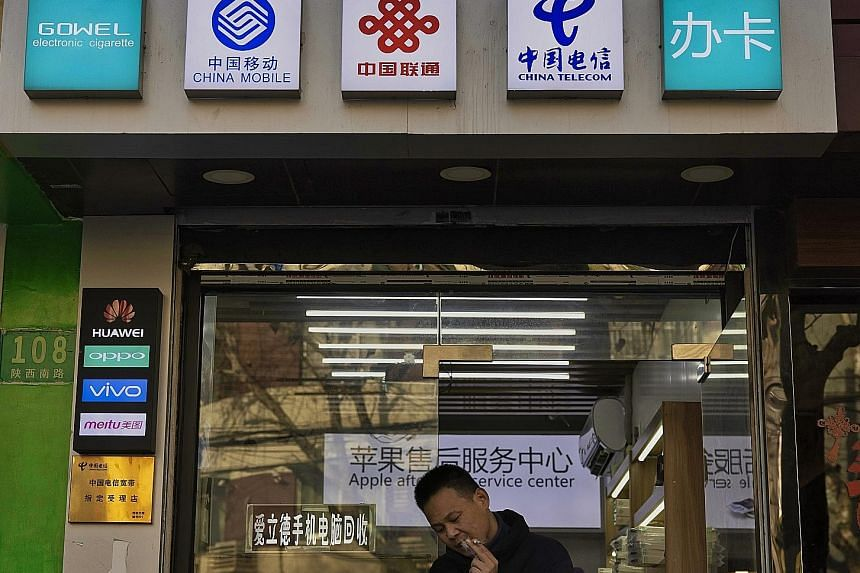 US banks Goldman Sachs, JPMorgan and Morgan Stanley said in filings to the Stock Exchange of Hong Kong that the products affected by the latest US ban are linked to telecoms companies China Mobile, China Unicom and China Telecom, or local indexes inc