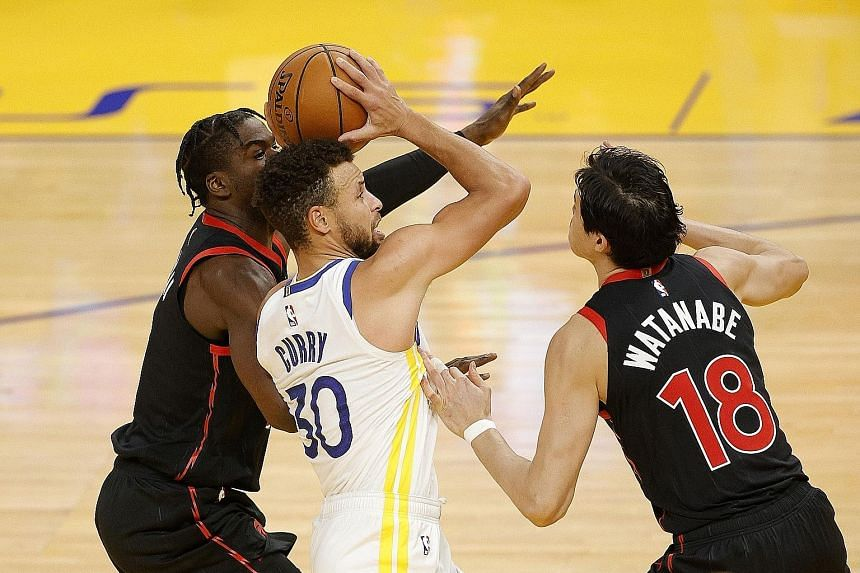 Golden State's Stephen Curry being guarded by Toronto's Terence Davis and Yuta Watanabe in Sunday's NBA game in San Francisco. The home team squeaked through 106-105 despite Curry's paltry 11-point contribution.