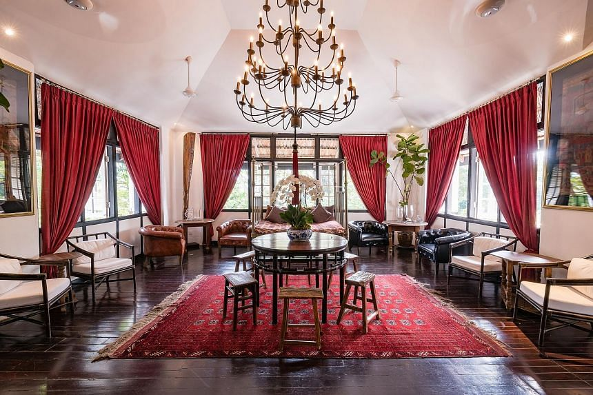 The Library commands attention with its chandelier and scarlet drapes. With wooden furniture (left) and loose tea leaves (above) instead of tea bags, the rooms score points for blending style and sustainability. (Left) Labrador Nature Reserve as seen