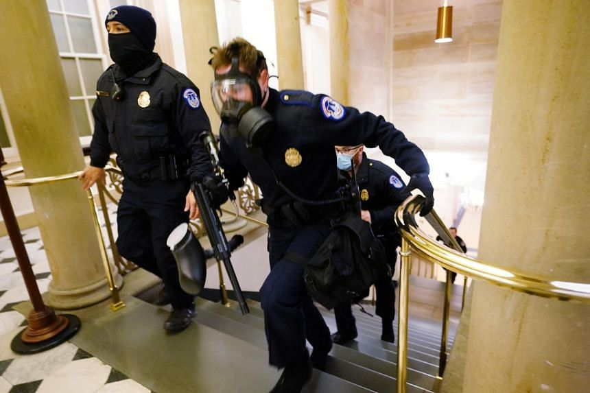 U.S. Capitol police officers take positions as protestors enter the building in Washington on Jan 6, 2021.