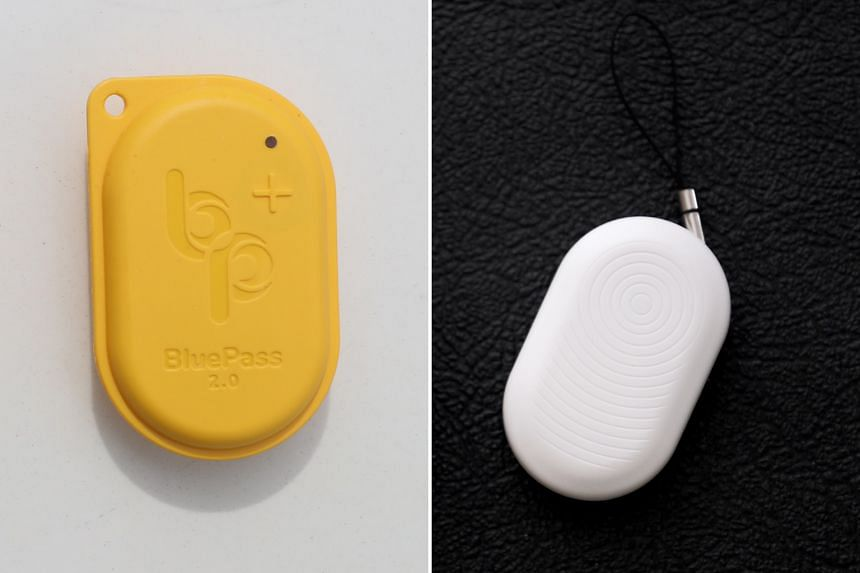 The BluePass token (left) and the TraceTogether token (right) both track close contacts by reading Bluetooth signal strengths. ST PHOTOS: GAVIN FOO