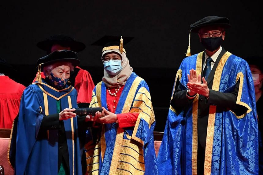 Dr Oon Chiew Seng, President Halimah Yacob and NUS President Tan Eng Chye at the University Cultural Centre on Jan 12, 2021.