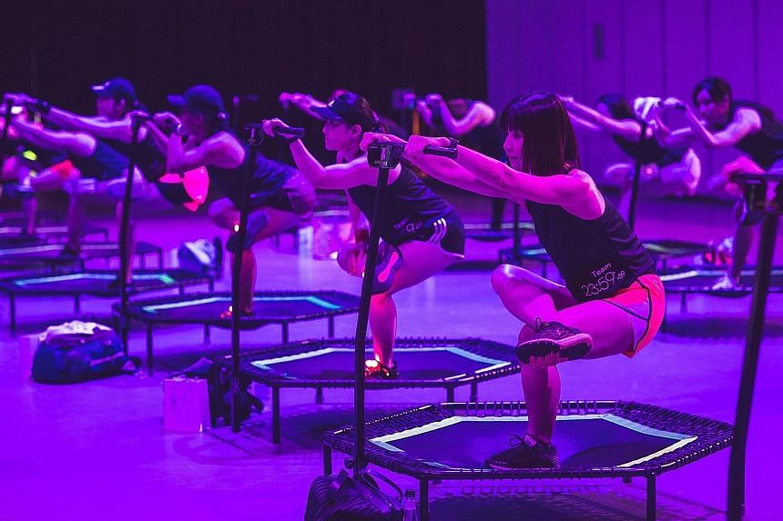 Try burpees, lunges or squats on a floating exercise mat in a pool at Skyline Aqua's FloatFit HIIT class. Students pole dancing at Slap Dance Studio. The activity incorporates dance and acrobatics. Jumping fitness involves aerobic exercises on mini t