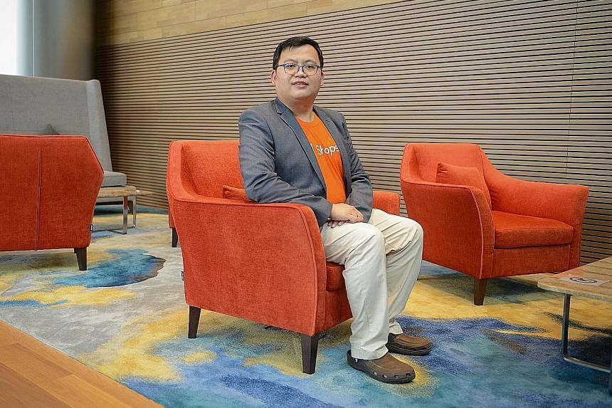 Former teacher Kenneth Chua is now five months into a new job as a systems quality assurance engineer for e-commerce platform Shopee, in a role that entails checking that the platform's application is working, troubleshooting and fixing bugs. ST PHOT