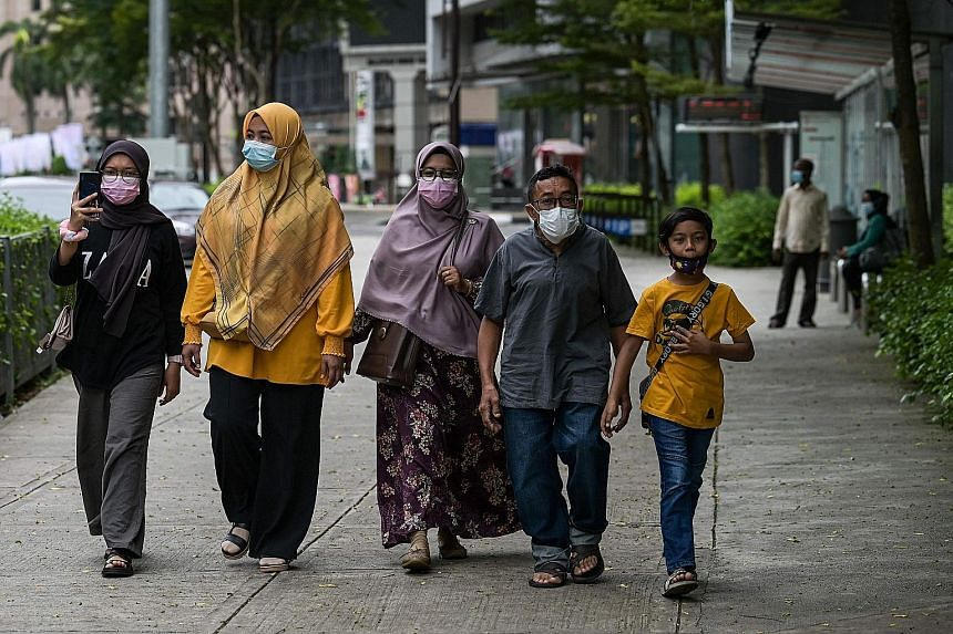 A few pedestrians on a street in Kuala Lumpur yesterday. From today, five states - Melaka, Johor, Penang, Selangor and Sabah - and the federal territories of Kuala Lumpur, Labuan and Putrajaya will re-enter the movement control order, where social ga