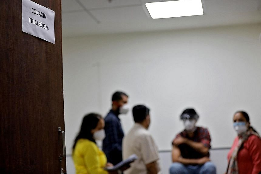 A health worker preparing to receive a Covaxin shot as part of a trial at the Gujarat Medical Education and Research Society in Ahmedabad, India, last November. Covaxin, a shot developed by India's Bharat Biotech International, has been approved for