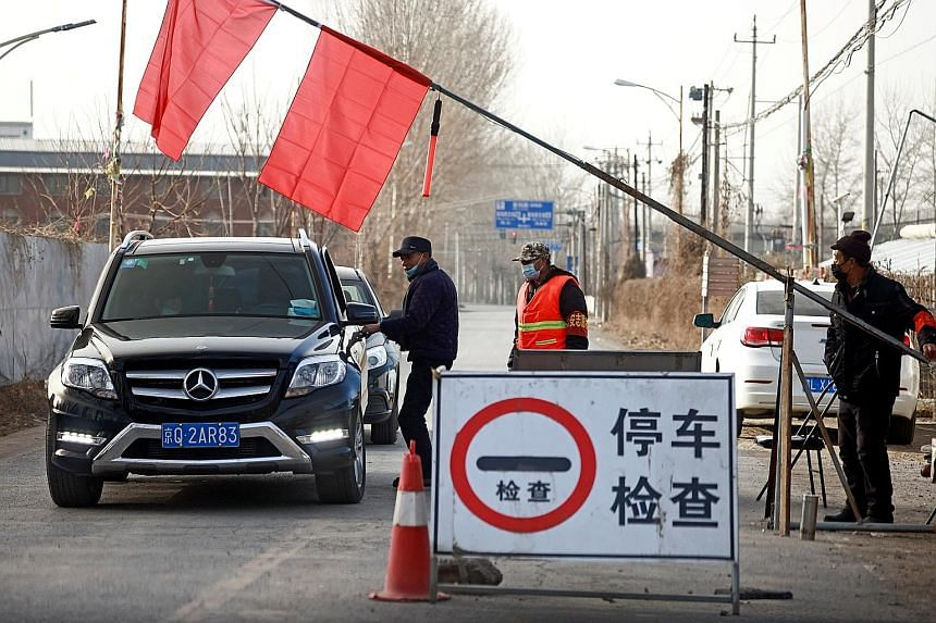 A checkpoint on the outskirts of Beijing near the provincial border with Hebei province yesterday. The number of new Covid-19 cases in mainland China reported yesterday remains a small fraction of the figure at the height of the outbreak early last y